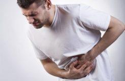 Давящая боль в области желудка — причины и лечение